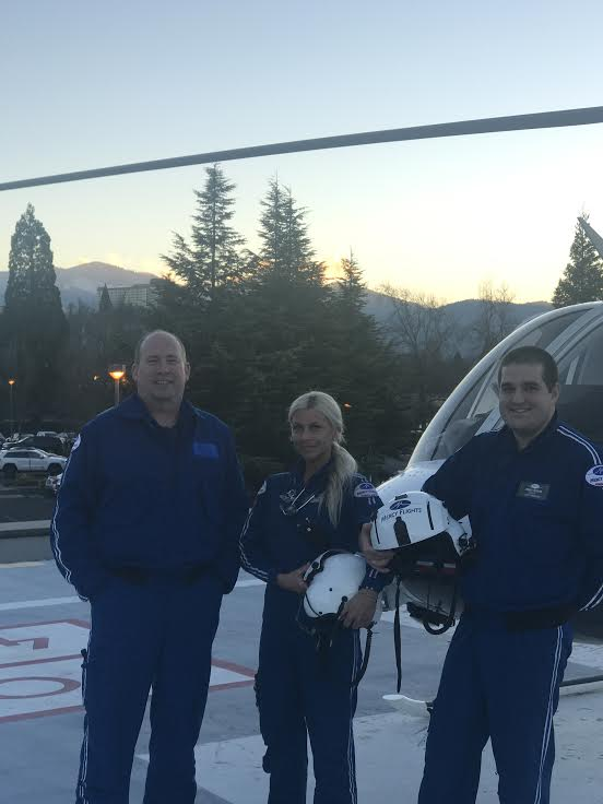 Shealy (center) and her airmed colleagues taking to the skies to save lives.