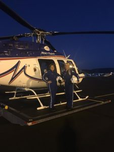 Shealy (right) and her colleague about to take flight in an airmed helicopter.