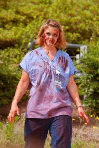 Make your Halloween scary by dressing up as a zombie nurse.
