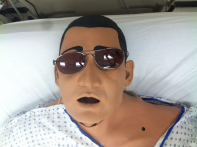 Dress up as a medical practice dummy wearing aviators.